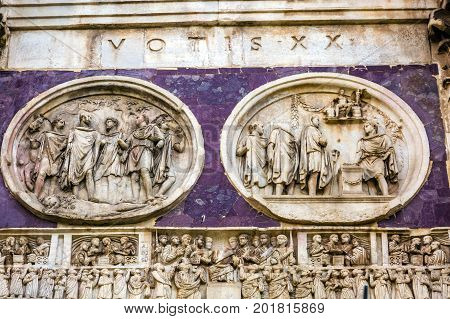 Statues Sculptures Arch of Constantine Rome Italy Arch built in 315 AD to celebrate Emperor Constantine's victory in 312 over co-emperor Maxenntius. Constantine attributed victory to vision of Jesus Christ made Christianity legal