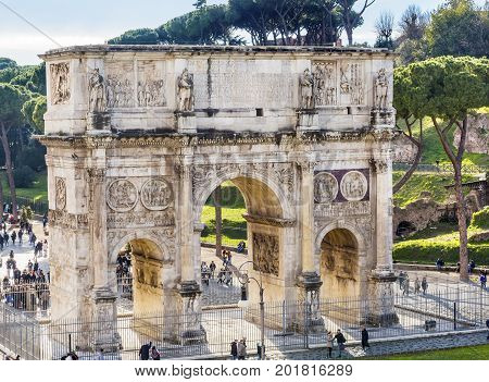 ROME, ITALY - January 19, 2017 Tourists Arch of Constantine Rome Italy Arch built in 315 AD to celebrate Emperor Constantine's victory in 312 over co-emperor Maxenntius. Constantine attributed victory to vision of Jesus Christ made Christianity legal