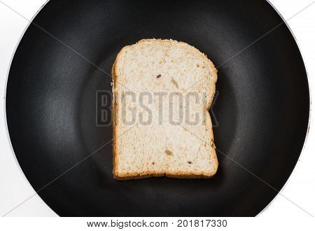 Natural 12 grains (barley buckwheat corn flaxseed millet rice rye sesame spelt sunflower triticale and wheat) sliced bread ready to toast on black pan over white countertop background