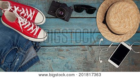 Still Life Of Various Items For Recreation, Clothing, Hat, Sneakers, Camera, Passport, Telephone, Su