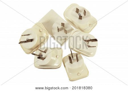 Pile of Power Adaptors on White Background