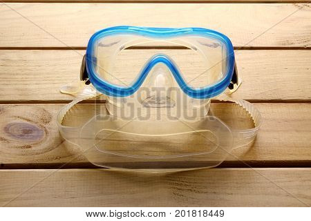Goggles and Snorkel on a Wooden Background