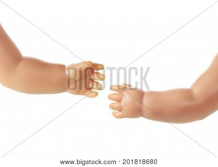 Plastic Doll Hands on a White Background