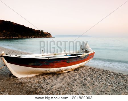 Boat on the sand of Kefalonia island Greece.