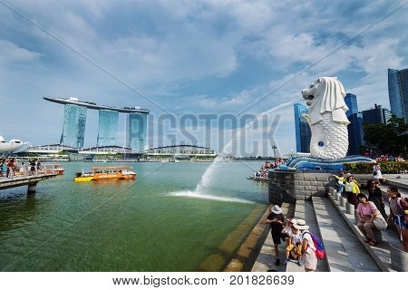 SINGAPORE - AUG 19 2017 : The Merlion Park with tourists visited (famous landmark of Singapore)