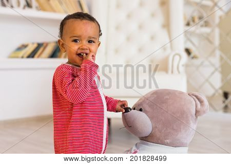 Portrait of a cute little African American boy smiling.