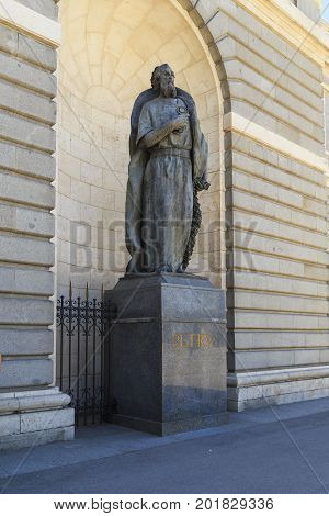 MADRID, SPAIN - MAY 24, 2017: This is monument to the Apostle Peter in the niche of the wall of the Cathedral of Santa Maria la Real de la Almudena.