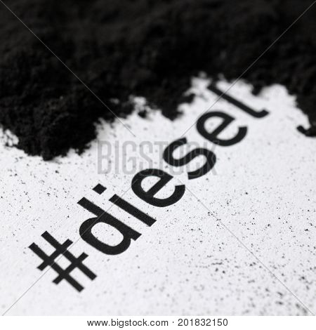 text hashtag diesel printed on paper with soot and soot pile - square format