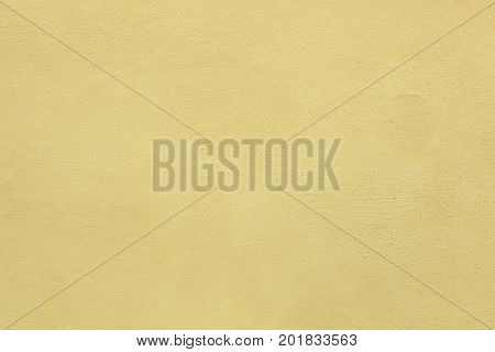 Yellow painted stucco wall. Background texture.