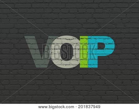 Web design concept: Painted multicolor text VOIP on Black Brick wall background