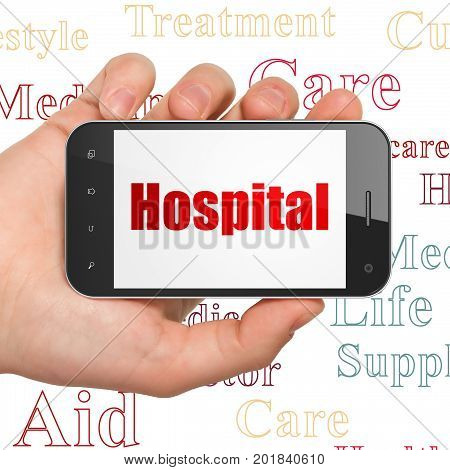 Medicine concept: Hand Holding Smartphone with  red text Hospital on display,  Tag Cloud background, 3D rendering