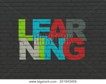 Learning concept: Painted multicolor text Learning on Black Brick wall background