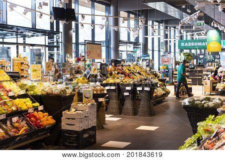 HAINBURG AN DER DONAU, AUSTRIA - 24 AUGUST 2017 : Supermarket with shelves of food and beverages Merkur in Austria