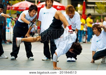 Thai Male Breakdancers One Handed Handstand