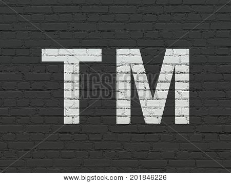 Law concept: Painted white Trademark icon on Black Brick wall background