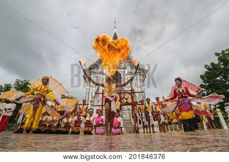 Sukhothai Thailand - August 5 2017: Teenage girls and boys performing northern style dancing and spitting fire to show to tourists in Buddhist temple