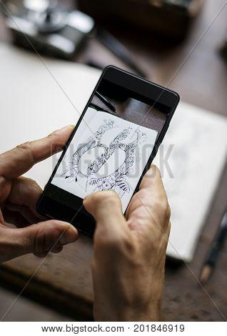 Closeup of mobile phone screen showing snap drawing art