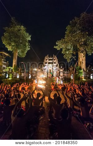 Ubud, Indonesia - August 8, 2016: Traditional Kecak Fire Dance ceremony in Hindu temple.