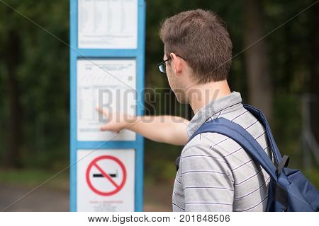 Student Guy Waiting For A Bus