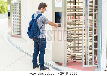 Young Man Puts The Card Into The Reader System