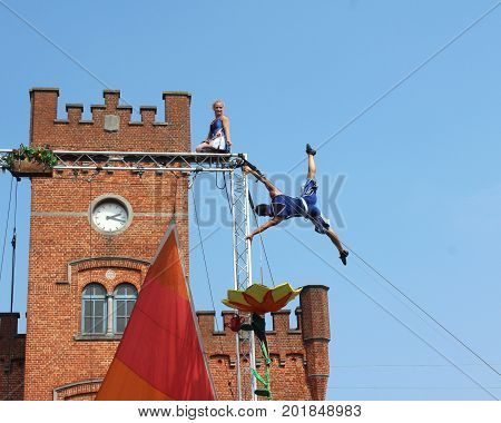 AALST, BELGIUM, AUGUST 27 2017: The acrobatic duo Circus unARTiq perform outside Aalst station, during the free open air festival Cirk. Cirk is a popular annual summer street festival.