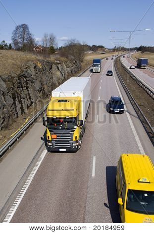 lorry surrounded by traffic