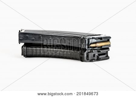 Empty cartridge for gun. 20 caliber handgun magazine on white loaded with hollow point cartridges.