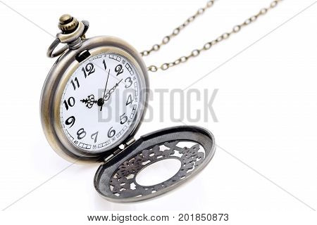 antique pocket watch with chain on white background