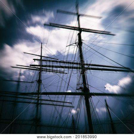 Vintage filtered image of a wooden sailing ship sail masts, pirate ship