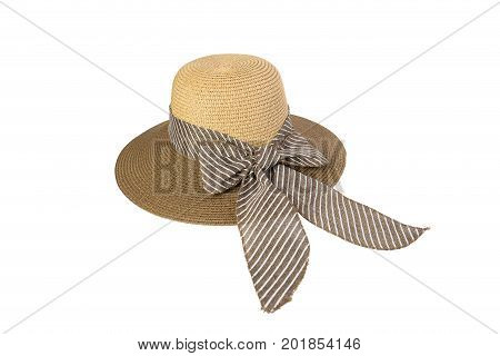 Woven hat with brown, decorated with a pink bow tie, isolated on white background.