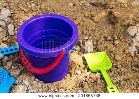 bright baby bucket and shovel in the sandbox