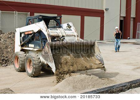 Bobcat Dumping Sand