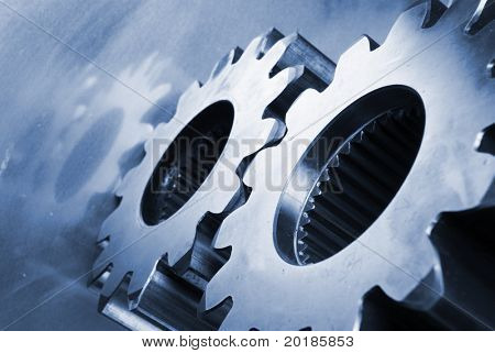 gear-wheels reflecting in aluminum