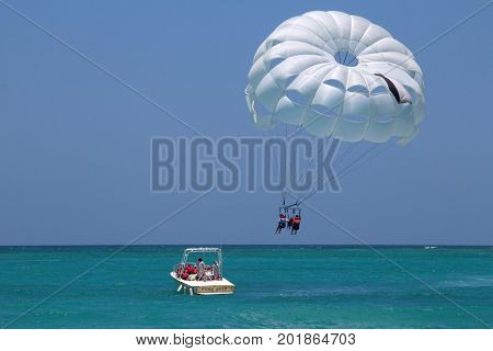 Punta Cana, Dominican Republic - July 03, 2016: Para-sailing in a blue sky. Para-sailing is a popular recreational activity among tourists in Punta Cana resorts.