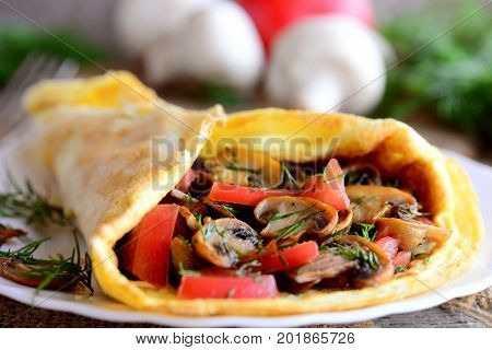Tomato mushroom omelette recipe. Easy omelette stuffed with fresh tomatoes slices and fried mushrooms. Closeup