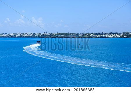 A Ferry Curving Toward Coast of Bermuda