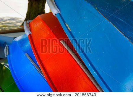 A Colorful Stack of Wood Row Boats