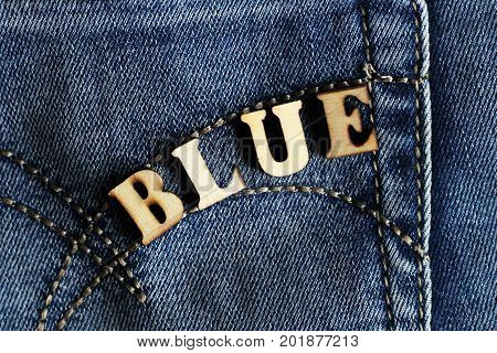 Wooden letters and jeans modern youth fashion
