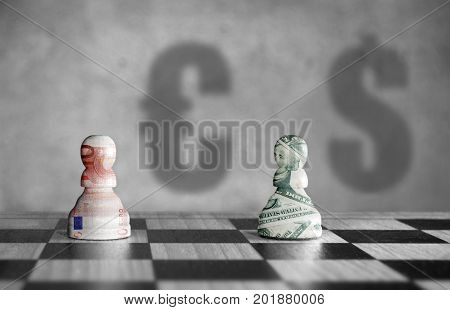 Chess pieces with euro verus dollar currency symbol shadows in the background