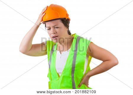 Attractive Woman Worker in Safety Jacket and Yellow Helmet Suffers from Backache on a white background