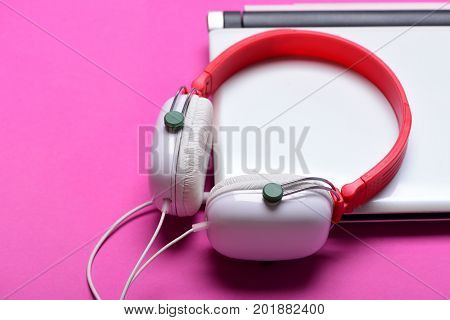 Earphones In Red And White Colors With Silver Computer