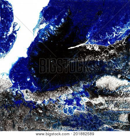 Liquid Acrylic paint, liquid artwork, abstract colorful background with colored painted cells, stains. Blue, white and black colors