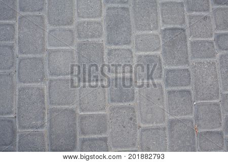 Stone pavement texture. Granite cobblestoned pavement background. Abstract background of old cobblestone pavement close-up. Seamless texture. Perfect tiled on all sides