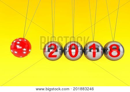 New Year concept. Spheres of Newton with 2018 on a yellow background. 3d Rendering