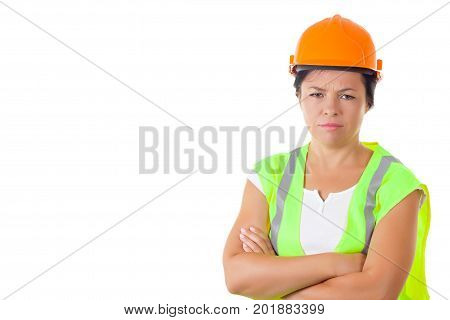 Serious Attractive Woman Worker in Safety Jacket and Yellow Helmet on a white background