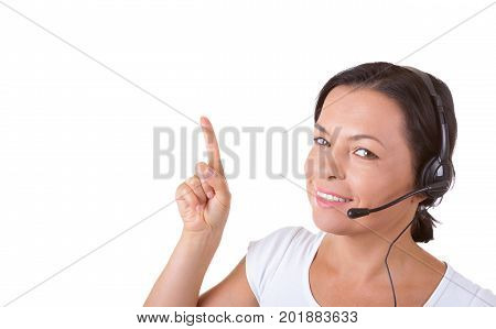 Happy Woman with Headset Working at Callcenter Shows Finger Direction to Copyspace for Yours Design on a white background