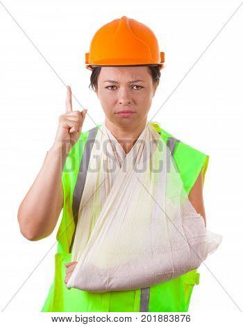 Attractive Woman Worker in Safety Jacket and Yellow Helmet with Injured Arm in Sling on a white background