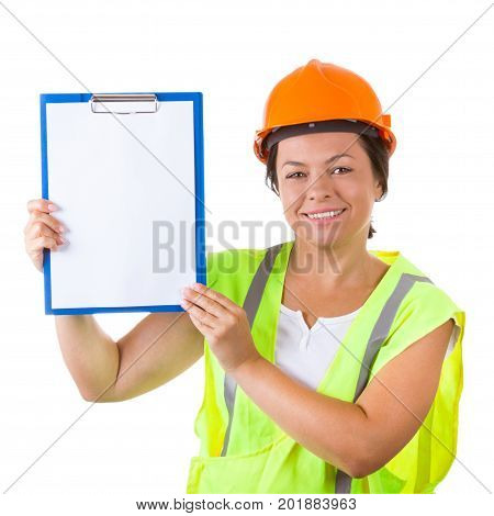 Attractive Woman Worker in Safety Jacket and Yellow Helmet Holding Clipboard with Blank Paper on a white background