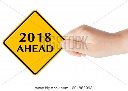 2018 Year Ahead Traffic Sign in Woman's Hand on a white background