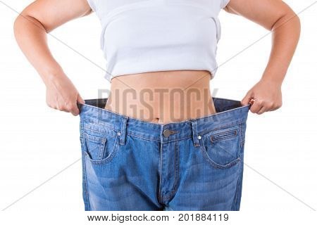 Diet Concept. Slim Women in Big Jeans Showing Successful Weight Loss extreme closeup